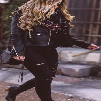 All black winter outfit styled with black leather jacket, black distressed jeans, plaid blanket sca