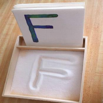 DIY salt tray with alphabet cards. Easy to make and kids have fun smoothing out the salt after corr