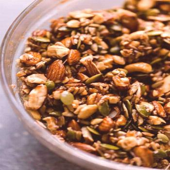 Paleo Granola -  Side angle shot of Paleo Granola ingredients in a food processor.  -