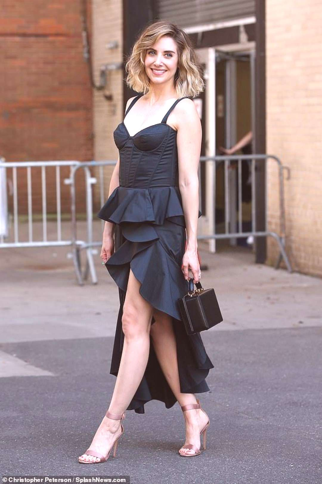 Alison Brie is radiant in black frilled top and matching dress as she attends event in New York | D