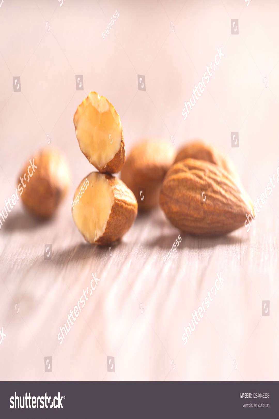Closeup of almonds with wooden background. ,