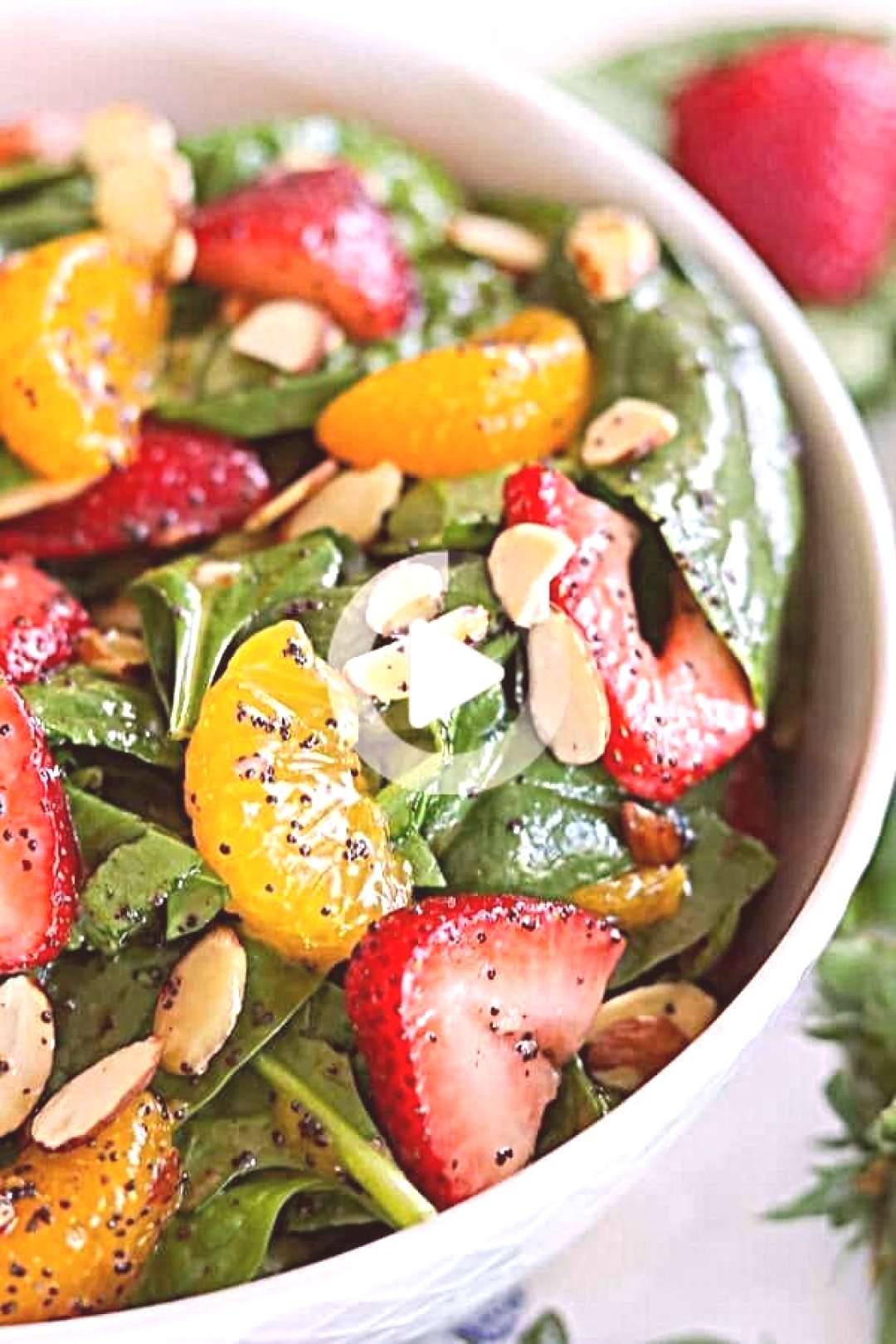 Fresh spinach, strawberries, mandarin oranges and sliced almonds make up this