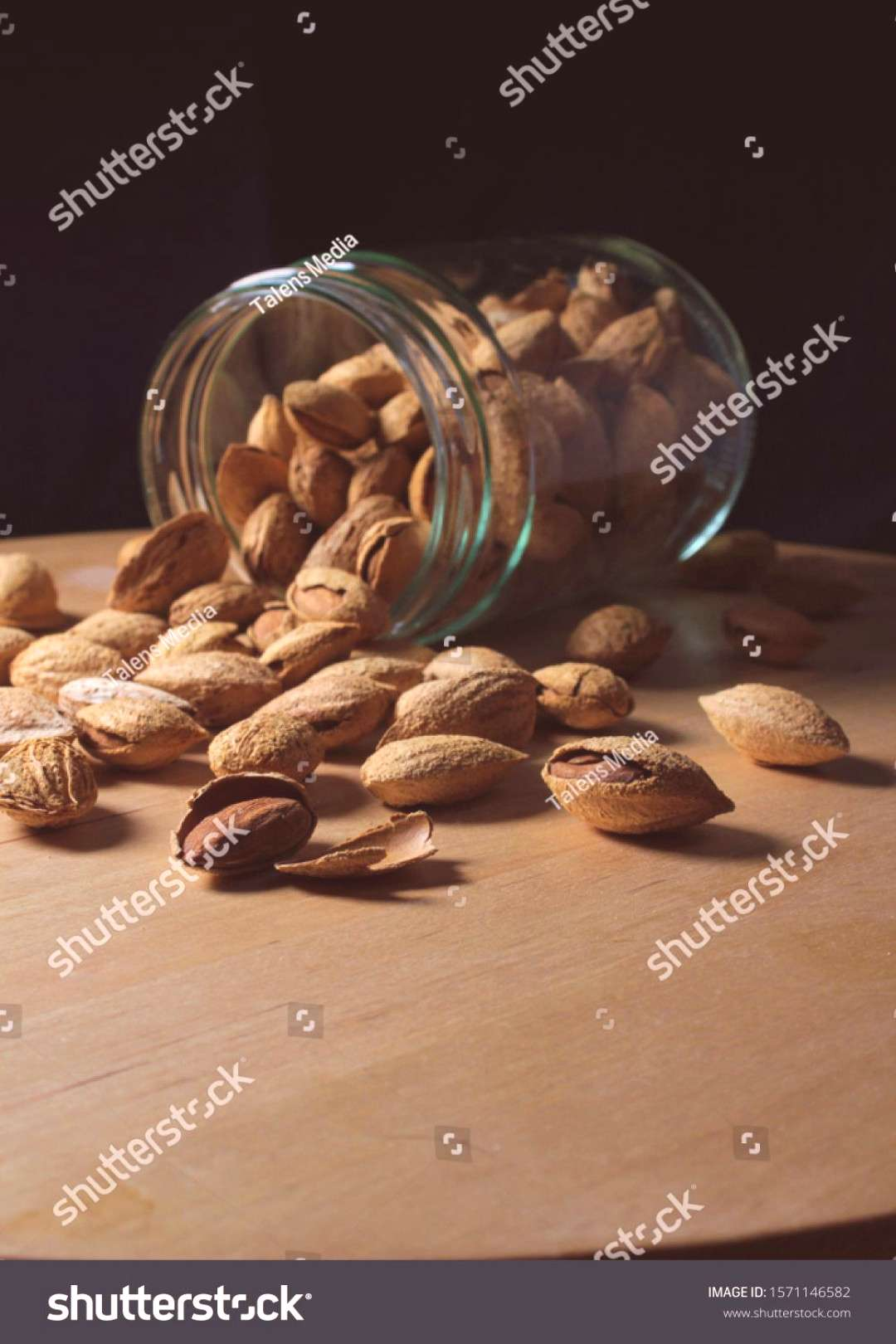 glass jar full of natural almonds with peel. Dried fruits from organic crops ,